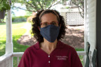 Dr. Angela Scarpa outside her home donning a face mask